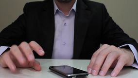 Businessman using mobile phone. For text messaging stock video