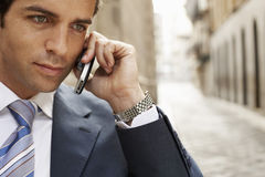 Businessman Using Mobilephone In Street Stock Images