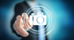 Businessman using modern camera application 3D rendering. Businessman on blurred background using modern camera application 3D rendering Stock Photography