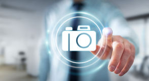 Businessman using modern camera application 3D rendering. Businessman on blurred background using modern camera application 3D rendering Stock Photo