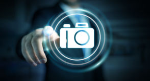 Businessman using modern camera application 3D rendering. Businessman on blurred background using modern camera application 3D rendering Stock Images
