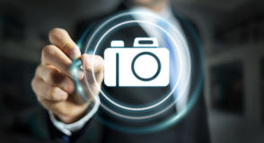 Businessman using modern camera application 3D rendering. Businessman on blurred background using modern camera application 3D rendering Royalty Free Stock Photography
