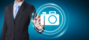 Businessman using modern camera application 3D rendering. Businessman on blurred background using modern camera application 3D rendering Stock Photos