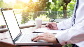Free Businessman Using Modern Laptop For Working At Personal Space Outdoor, Wireless Connection Internet On His Notebook Computer Stock Images - 96790104