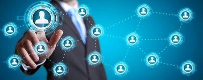Businessman using modern social network Stock Images