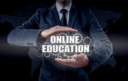 Businessman using modern tablet pc and pressing Online Education icon on virtual screen. Businessman using modern tablet pc and pressing Online Education icon Royalty Free Stock Images
