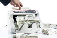 Businessman using money counting machine Royalty Free Stock Photos