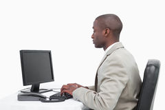 Businessman using a monitor Stock Photography