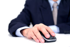 Businessman using mouse. Businessman using a mouse on white background Stock Photography