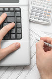Businessman using notebook and calculator Royalty Free Stock Photo