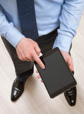 Businessman using a pad Stock Images