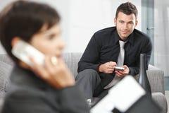 Businessman using palmtop Royalty Free Stock Image