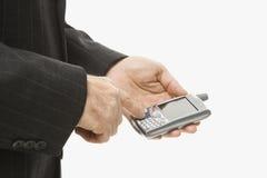 Businessman using PDA Stock Photography