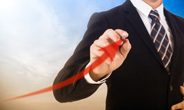 Businessman using pen for draw growth graph Royalty Free Stock Images