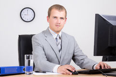 Businessman using personal computer in office Stock Photography