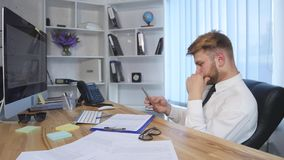 Businessman Using a Phone at the Office stock video footage