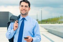 Businessman using phone on travel Stock Photo