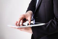 Businessman using pinch zoom Stock Image