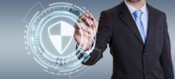 Businessman using shield safe protection to protect his datas 3D. Businessman on blurred background using shield safe protection to protect his datas 3D Royalty Free Stock Image