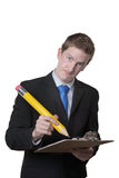 Businessman using silly pencil Royalty Free Stock Image