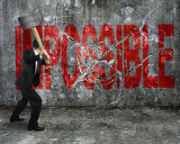 Free Businessman Using Sledgehammer Cracking Red Impossible Word Brok Stock Photos - 48104353