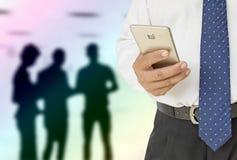 Businessman using smart phone on Stock Photography