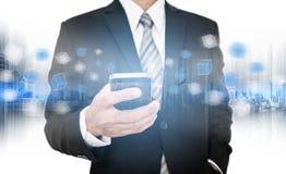 Businessman using smart phone, business network communication technology Royalty Free Stock Photography