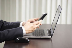 Businessman using smart phone Stock Photography