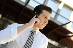 Businessman using a smart phone in an office building Stock Photos