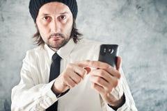 Businessman using smart phone Stock Photos