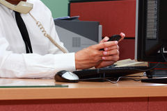 Businessman using smart phone during working Stock Images