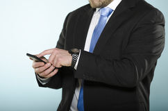 Businessman using smartphone. Royalty Free Stock Photos