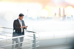 Businessman using smartphone Royalty Free Stock Photo