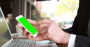 Businessman using smartphone. In bar stock footage