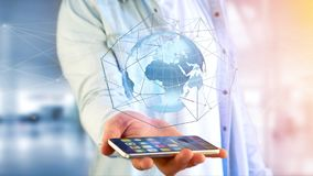 Businessman using smartphone with a Connected network over a ear. View of a Businessman using smartphone with a Connected network over a earth globe concept on a Stock Photo