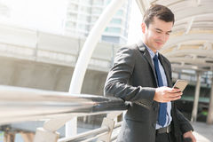 Businessman using smartphone Stock Photos