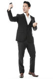 Businessman using a smartphone. Exhilarated businessman using a smartphone Royalty Free Stock Photo
