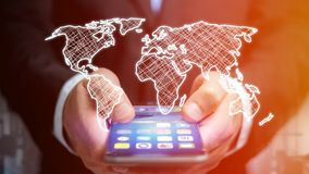 Businessman using a smartphone with a Hand drawn world map on a. View of a Businessman using a smartphone with a Hand drawn world map on a futuristic interface Royalty Free Stock Images