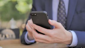 Businessman Using Smartphone. The Businessman Using Smartphone, high quality stock video footage