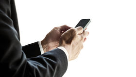 Businessman using smartphone, isolated on white background Royalty Free Stock Images