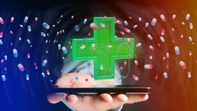 Businessman using a smartphone with a Lighting pharmacy cross an. View of a Businessman using a smartphone with a Lighting pharmacy cross and a stethoscope - 3d Stock Photos