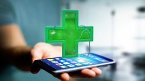 Businessman using a smartphone with a Lighting pharmacy cross an. View of a Businessman using a smartphone with a Lighting pharmacy cross and a stethoscope - 3d Stock Images