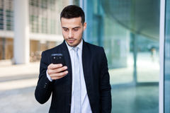 Businessman using a smartphone Stock Image