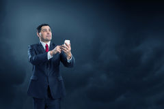 Businessman using smartphone . Mixed media Royalty Free Stock Photos