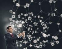 Businessman using smartphone . Mixed media. Senior businessman using his smartphone for business and communication 3D rendering Stock Photos