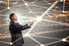 Businessman using smartphone . Mixed media. Senior businessman using his smartphone for business and communication 3D rendering Stock Image