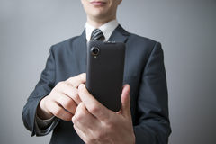 Businessman using smartphone Royalty Free Stock Photography