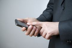Businessman using smartphone Royalty Free Stock Photos