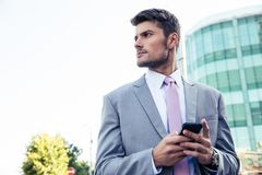BUsinessman using smartphone ourdoors Stock Images