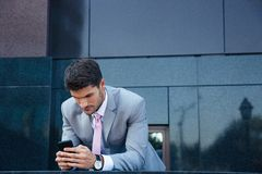 Businessman using smartphone outdoors Stock Image